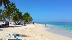 CAYO LEVANTADO, SAMANA, DOMENICAN REPUBLIC FEBRUARY 09 People at the beach in Stock Footage