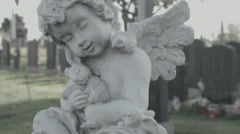 Winged Angel Statue at Cemetery - Film Log Stock Footage