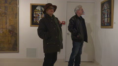 Retired people, mature couple visiting museum, art exhibition - panoramic 2 Stock Footage