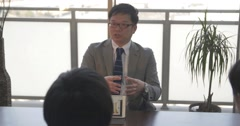 Japanese business man talking to his staff about stratagies Stock Footage