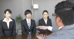 Japanese boss explains company at a job interview Stock Footage