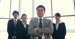 Japanese boss stands with confident pose in front of his team Stock Footage