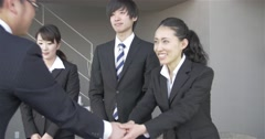 Japanese job candidates shake hands with potential employer after the interview Stock Footage