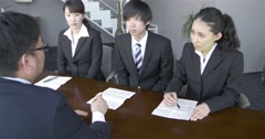 Japanese manager explaining the terms of the contract - stock footage