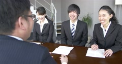 Positive meeting with Japanese boss and staff Stock Footage