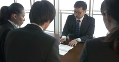 Japanese boss explains contracts to new employees Stock Footage