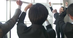 Energetic Japanese business women motivates the sales team Stock Footage