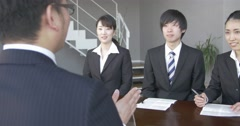 Japanese business man interviews three job candidates. Stock Footage