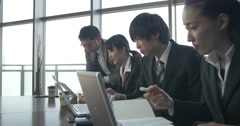 Busy Japanese office at a new start up company team work Stock Footage
