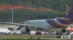 Airbus 330 taxiing in Phuket airport Stock Footage