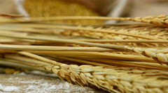 Dolly of golden wheat stems laying on an old wooden table Stock Footage