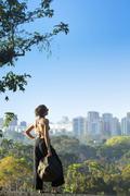 Mixed race woman admiring cityscape, Rio de Janeiro, Brazil Stock Photos