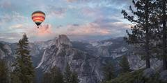 Hot air balloon flying over Yosemite, California, United States Kuvituskuvat