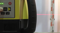 Operating laser level Stock Footage