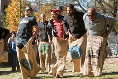 Men Compete In Old Fashioned Sack Race At Atlanta Festival - stock photo