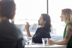 Business people talking in office meeting - stock photo