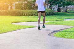 Marathon man runner in urban running track. Stock Photos