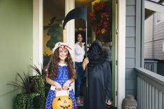 Children trick-or-treating on Halloween Stock Photos