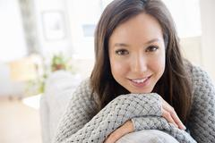 Mixed race woman smiling - stock photo