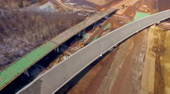 New highway construction project, dynamic aerial flyover view Stock Footage