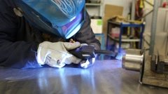 Welding with torch iron tubes in Italy Stock Footage