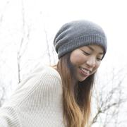Japanese woman wearing beanie outdoors - stock photo