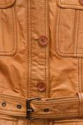 Texture a shabby brown leather jacket. Stock Photos