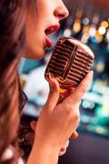 Beautiful Singing Glamour Model Singer. Karaoke song Kuvituskuvat