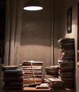 Stack of books under spotlight Stock Photos