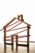 House shape wrapped in phone cord Stock Photos
