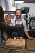 Customer purchasing pizza in cafe Stock Photos