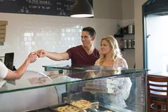 Customers purchasing pizza in cafe Stock Photos
