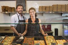 Caucasian servers smiling in cafe Kuvituskuvat