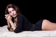 beautiful girl on furs - stock photo