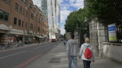 Walking on St Thomas Street in London Stock Footage
