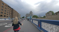 Girl and other people walking on Tower Bridge in London Stock Footage