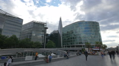 Walking and relaxing on More London Riverside in London Stock Footage