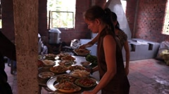 Camera follows waitress serving food outside in Vietnam Stock Footage