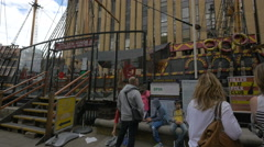 People standing near Golden Hinde II museum in London Stock Footage