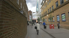 Walking on the street, close to Shangri-La Hotel in London Stock Footage