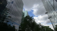 More London Riverside with trees and modern buildings in London Stock Footage