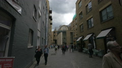 Tourists walking close to the Winchester Palace on Clink Street in London Stock Footage