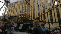 People relaxing near Golden Hinde II museum in London Stock Footage