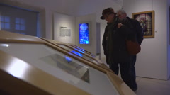 Retired people, mature couple visiting museum, art exhibition 1 Stock Footage