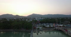 Aerial pan over chalong pier big buddha Stock Footage