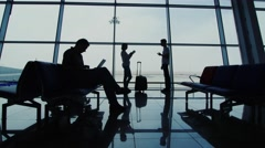 Life in the airport terminal, a family waiting for a flight - stock footage