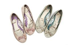 Pairs of Pink and Blue Worn-Out Ladies Shoes - stock photo