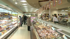 People in supermarket go shopping. Stock Footage