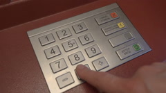 Finger entering secret pin number at ATM Stock Footage