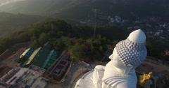 Aerial orbit behind big buddha statue Stock Footage